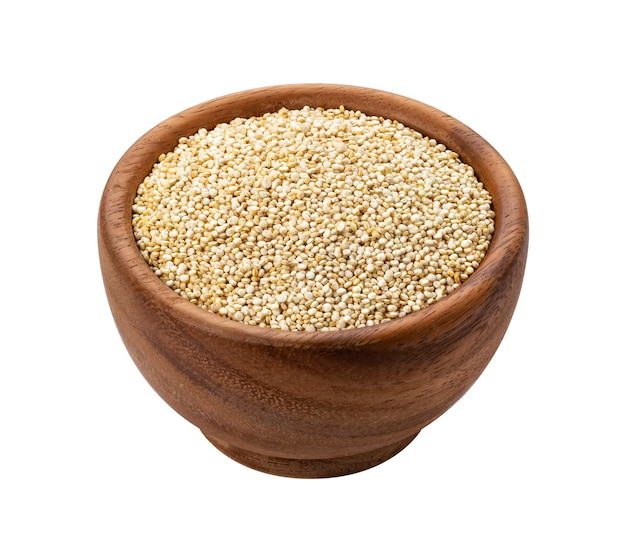 Wooden bowl of quinoa seeds isolated