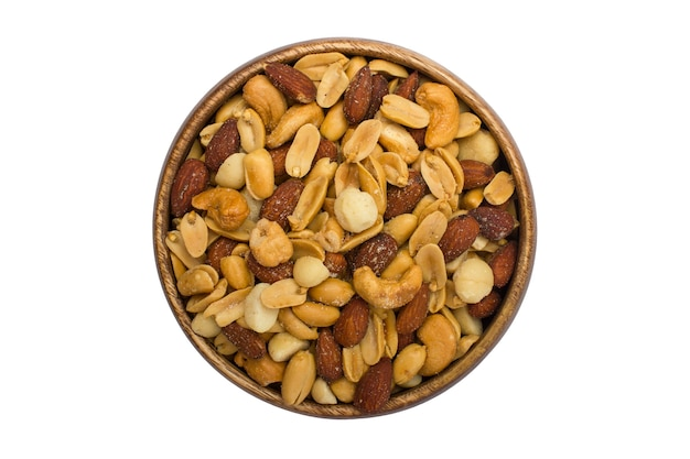 Wooden bowl with mixed nuts on a white background. healthy food and snacks. nuts, pistachios, almonds, hazelnuts and cashews