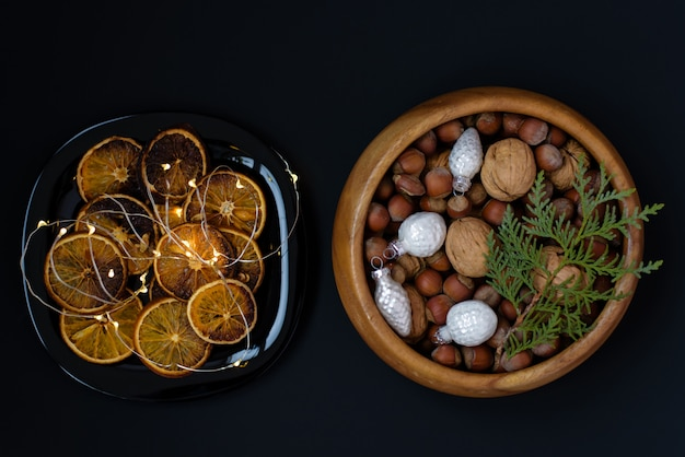 Wooden bowl with nuts, walnuts and hazelnuts.