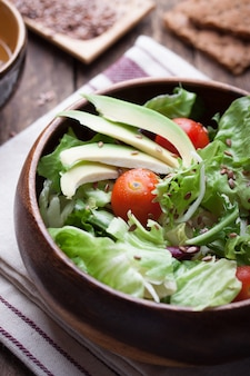 Wooden bowl with salad