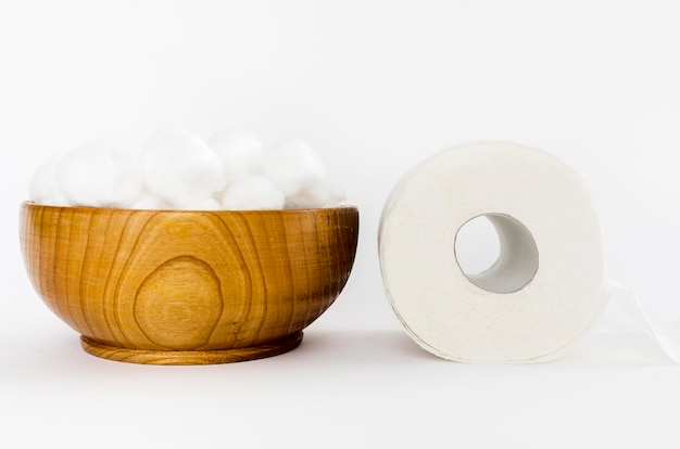 Wooden bowl with toilet paper