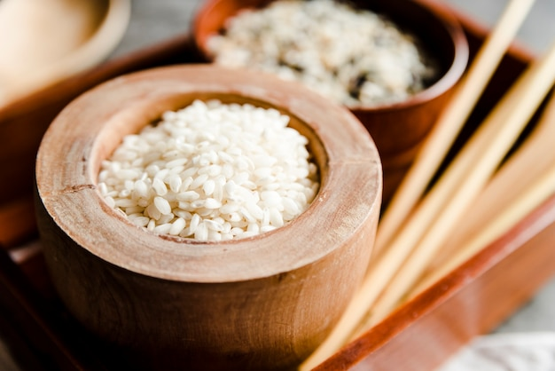 Wooden bowl with white rice