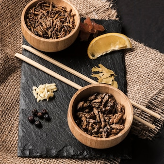 Wooden bowls with roasted silkworms