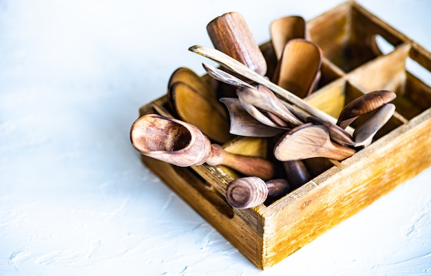 Wooden box full of spoons