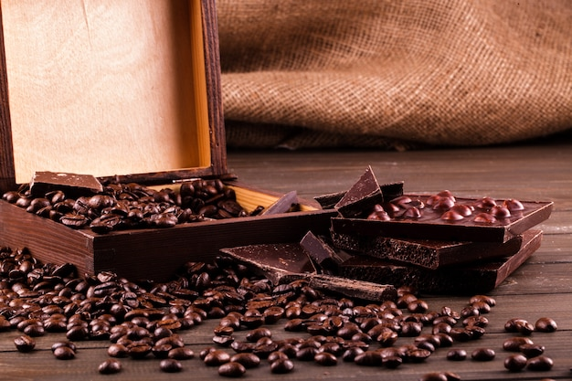 Wooden box with coffee beans and chocolate