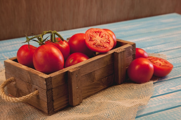 Wooden box with fresh tomatoes