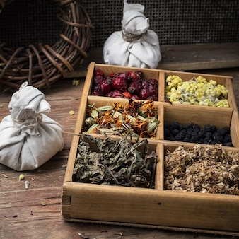 Wooden box with herbs in the rural style.