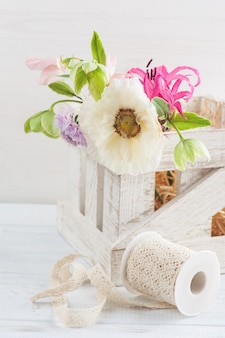 Wooden box with poppy and flowers