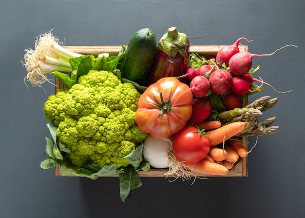 Wooden box with vegetables, high view