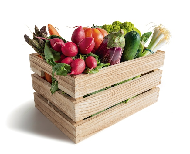 Wooden box with vegetables isolated from the white background