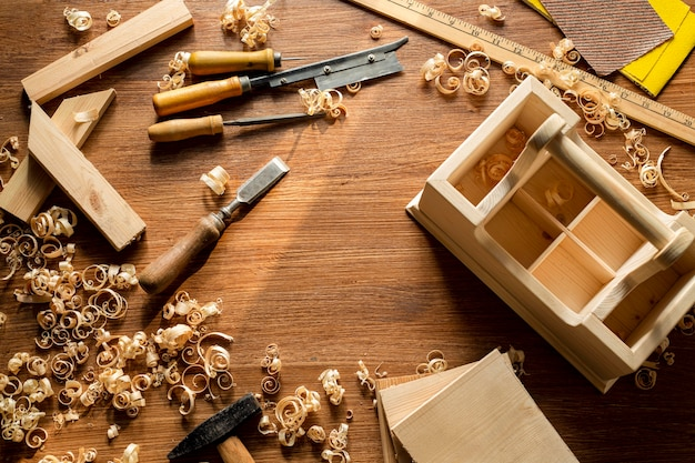 Wooden box and wood sawdust in workshop copy space