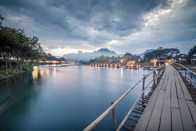 Wooden bridge across nam song river at vang vieng.