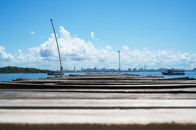 Wooden bridge pier in sea at khao lan, opposite pattaya city beach, thailand