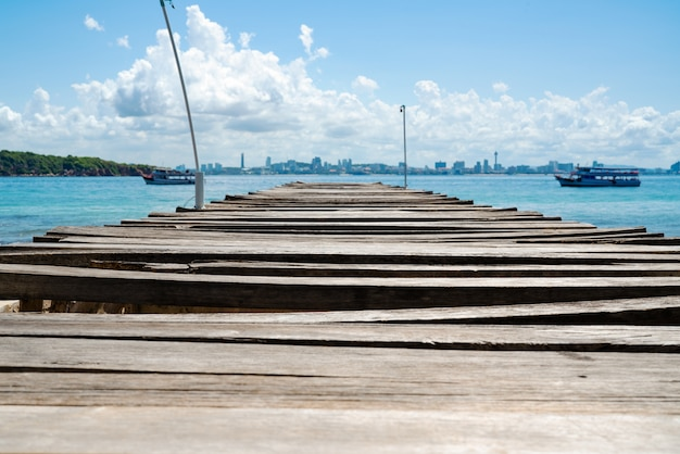 Wooden bridge pier in the sea at khao lan, opposite with pattaya city, thailand