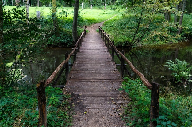 Wooden bridge over the river in the