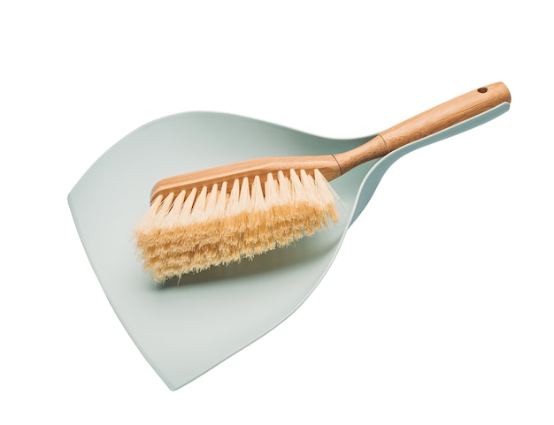 Wooden broom and dustpan isolated on white