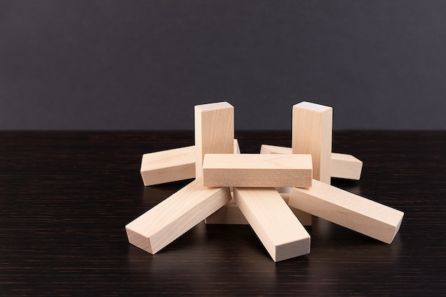 Wooden building blocks tower on wooden
