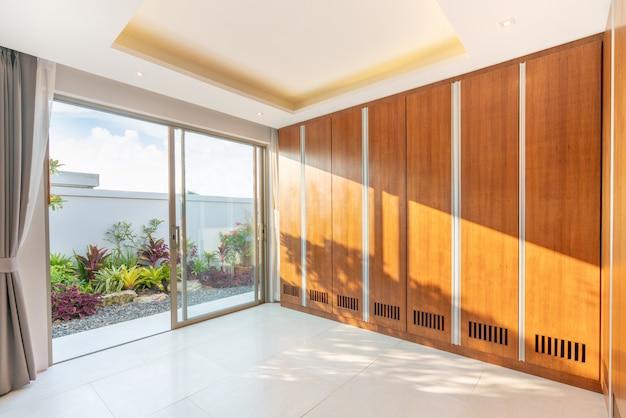 Wooden built in wardrobe with green garden