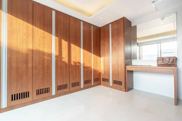Wooden built in wardrobe with green garden