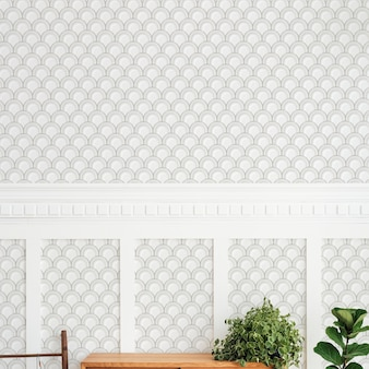 Wooden cabinet by a white and gray semicircle patterned wall
