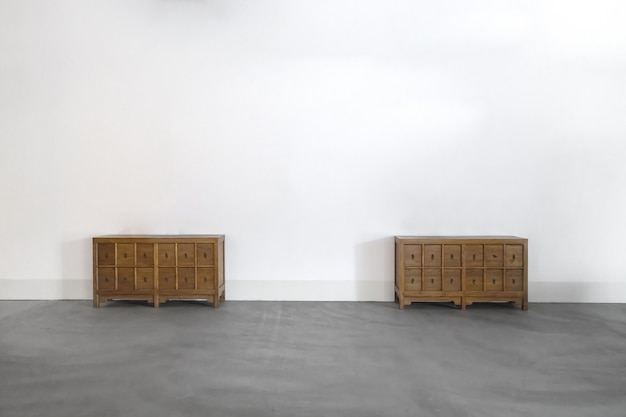 Wooden cabinet on the concrete floor