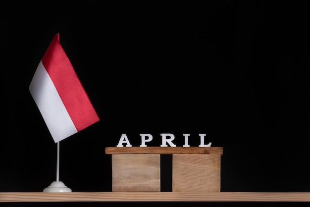 Wooden calendar of april with polish flag