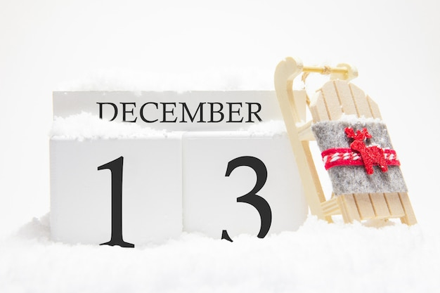 Wooden calendar for december, 13 th day of the winter month.