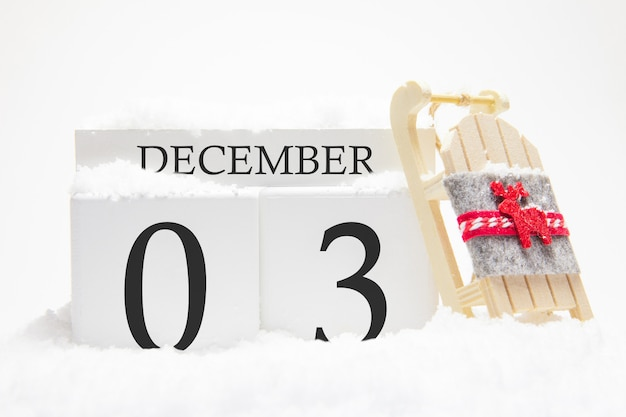 Wooden calendar for december, 3 rd day of the winter month.