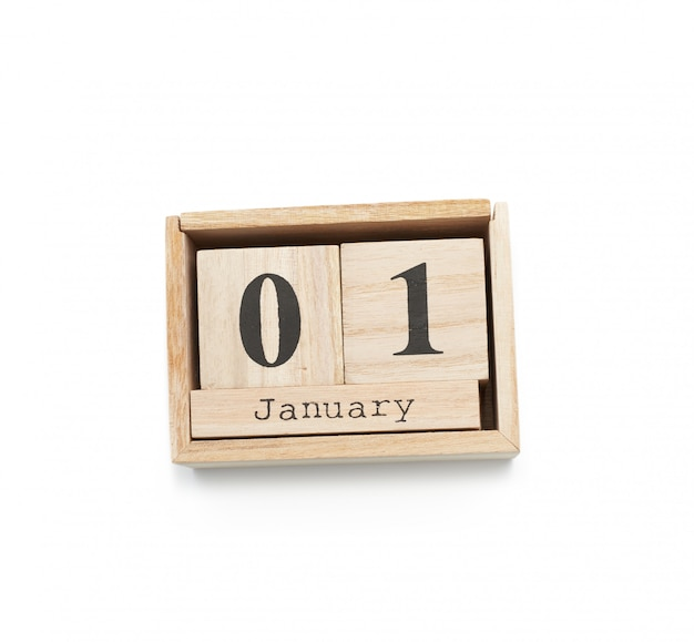 Wooden calendar made of blocks isolated on white background