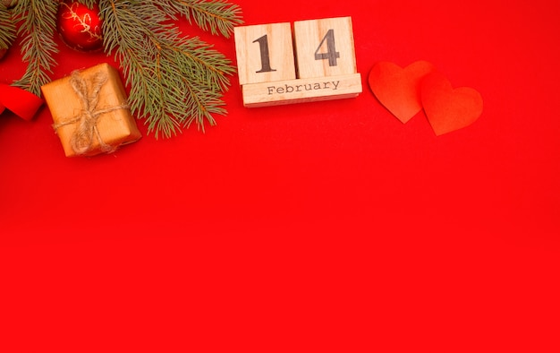 Wooden calendar on a red background. valentine's day february 14