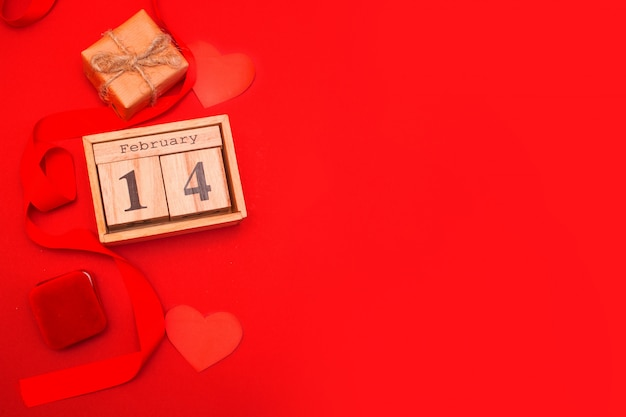 Wooden calendar on a red background. valentine's day