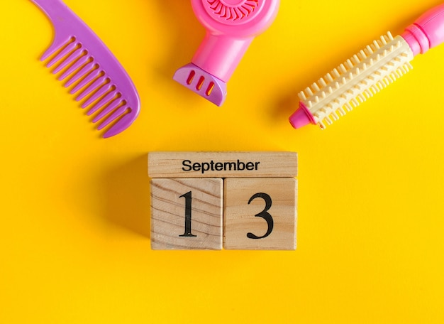 Wooden calendar for september 13 and a toy set for the barber.