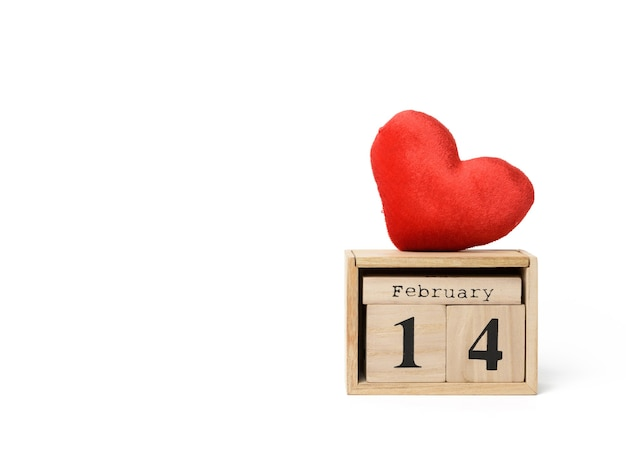 Wooden calendar with date 14 february and red textile heart on white background, copy space