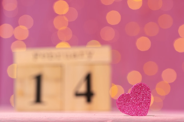 Wooden calendar with date 14th of february close up