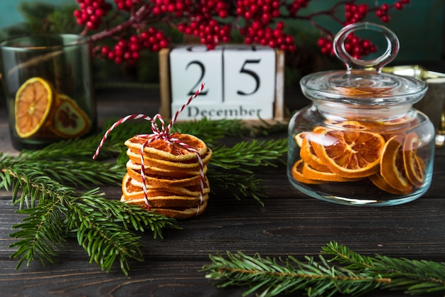 Wooden calendar with date 25 december, christmas decor, orange chips on wood