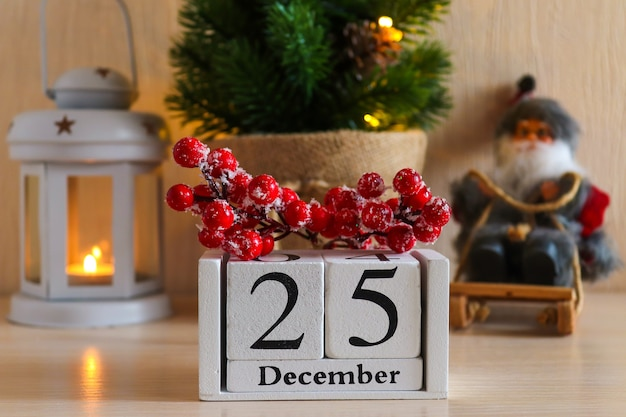 Wooden calendar with date december  against christmas festive background christmas home composition