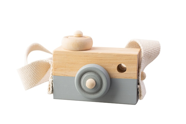 Wooden camera toy isolated on white background.