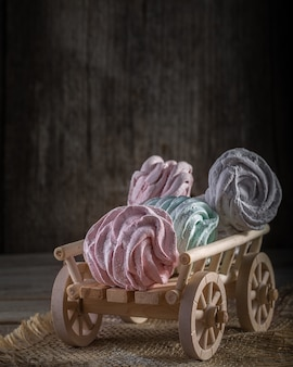 A wooden cart with homemade sweet marshmallow.
