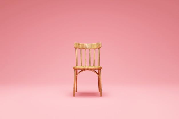 ピンクのスタジオの背景に木製の椅子