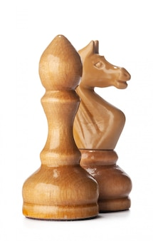 Wooden chess pieces close up isolated on white