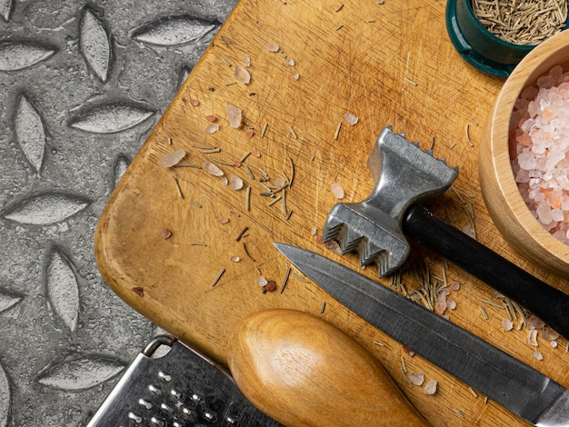 The wooden chopping board  and kitchen equipment top view for food concept