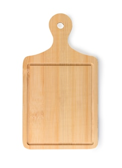 Wooden chopping board on a white