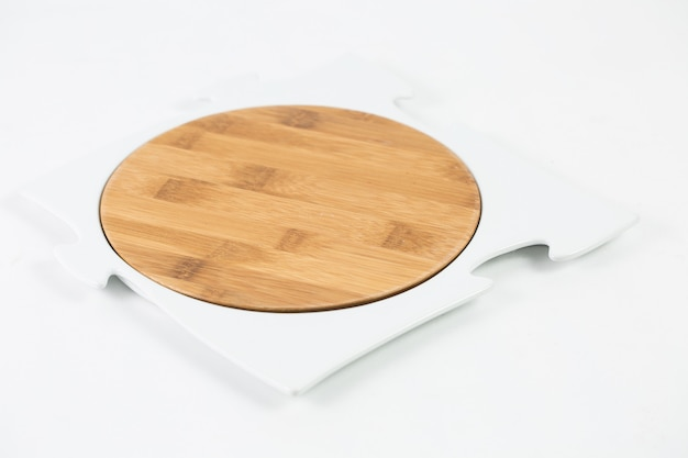 Wooden chopping board with a puzzle frame isolated on a white table
