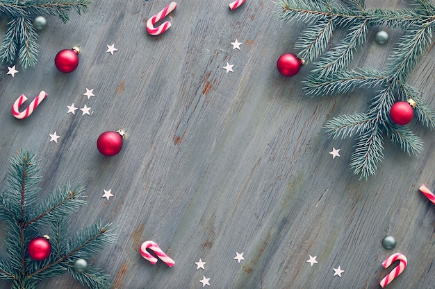 Wooden christmas background decorated with natural fir twigs