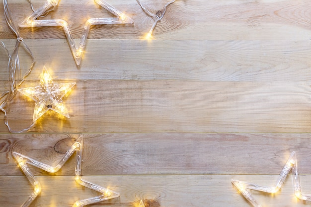 Wooden  christmas background with star shaped lights.