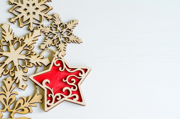 Wooden christmas decorations with shape of stars and snowflakes