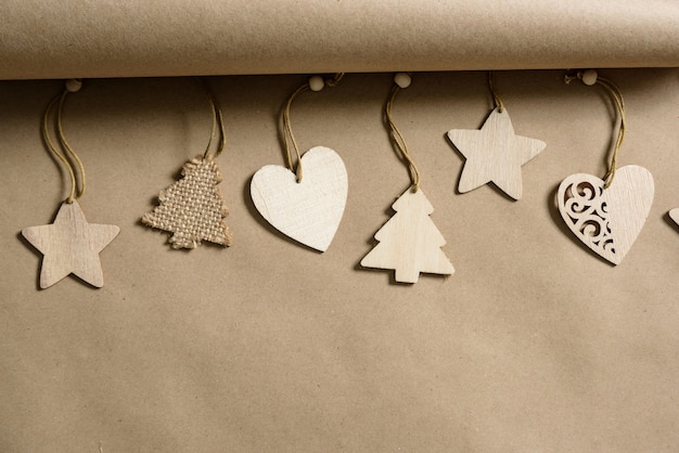 Wooden christmas toys on a background of craft paper with copy space.