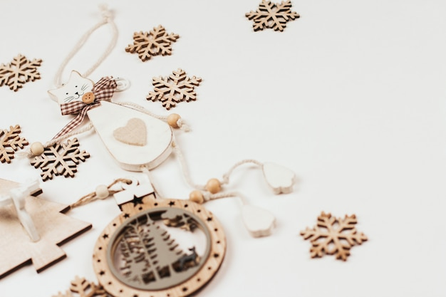 Wooden christmas toys and snowflakes. laser cutting of plywood.