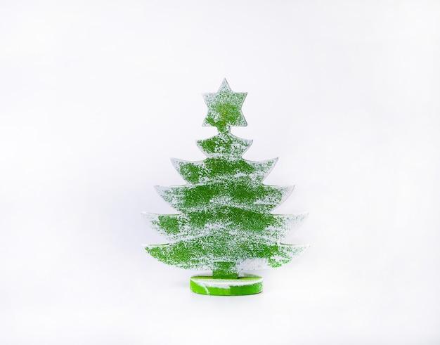 Wooden christmas tree decoration on white. xmas inspiration.