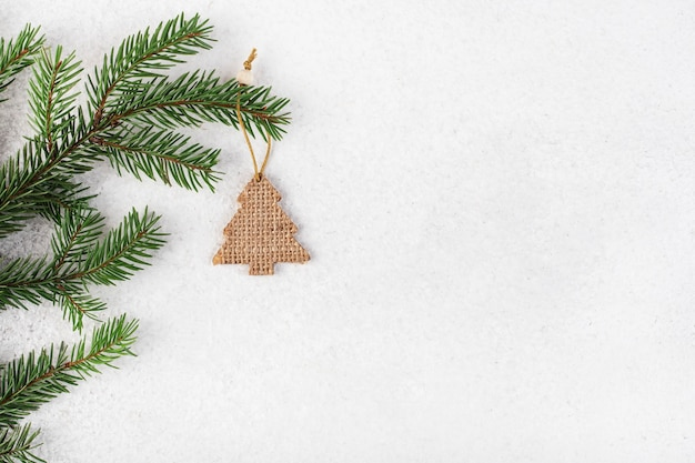 Wooden christmas tree eco toys on fir branches, top view